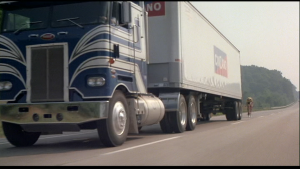 Drafting behind a semi trailer on a divided highway.