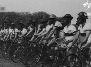 A 1943 newsreel shows Australian young men donning gas masks on their bicycles in preparation for wartime messenger service in the ARP.